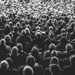 black and white photo of an audience at some event