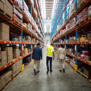 Warehouse workers walking down aisle