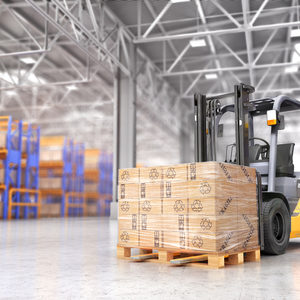 Forklift with a pallet in a warehouse
